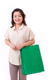 Happy middle aged asian woman with shopping bag Stock Photos