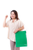 Happy middle aged asian woman with shopping bag Stock Image