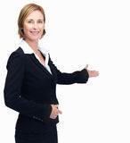 Happy middle aged business woman showing copyspace Royalty Free Stock Photo
