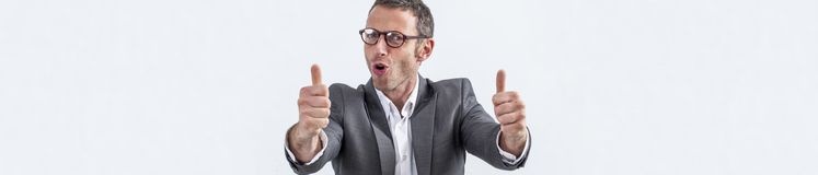 Happy middle aged businessman with eyeglasses and thumbs up, banner stock photo