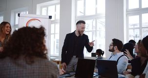 Happy middle aged businessman leading active discussion at modern office seminar with multiethnic corporate employees. stock footage