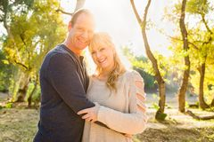 Happy Middle Aged Caucasian Couple Portrait Outdoors. Happy Middle Aged Caucasian Couple Pose for a Portrait Outdoors stock images