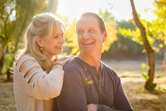 Attractive Middle Aged Caucasian Couple Portrait Outdoors. Happy Middle Aged Caucasian Couple Pose for a Portrait Outdoors stock photography