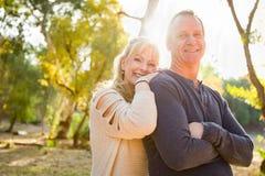 Smiling Middle Aged Caucasian Couple Portrait Outdoors. Happy Middle Aged Caucasian Couple Pose for a Portrait Outdoors stock photos