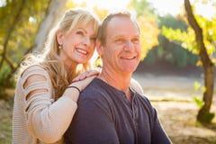 Blonde Middle Aged Caucasian Couple Portrait Outdoors. Happy Middle Aged Caucasian Couple Pose for a Portrait Outdoors stock images