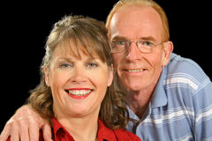 Happy Middle Aged Couple. Smiling and looking to camera Stock Photos