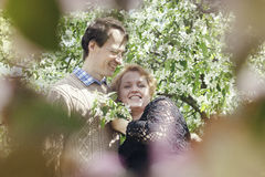Happy middle aged couple in apple trees garden Stock Photos