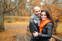 Happy middle-aged couple on autumn day Stock Photos