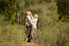 Happy middle-aged couple dancing in the autumn park Royalty Free Stock Photography