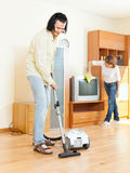 Happy middle-aged couple doing housework Stock Photography