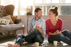 Happy middle aged couple enjoying free time at home Royalty Free Stock Image