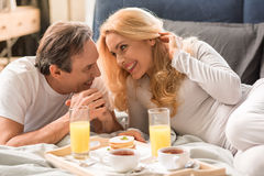 Happy middle aged couple having breakfast together Royalty Free Stock Image