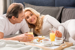 Happy middle aged couple having breakfast together Stock Photo