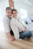 Happy middle-aged couple at home Royalty Free Stock Photos