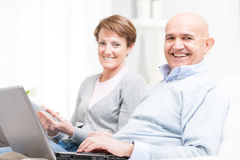 Happy middle-aged couple relaxing at home Royalty Free Stock Photo