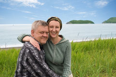 Happy middle aged couple by the sea. Stock Photos