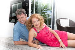 Happy middle aged couple spending romantic time by pool Royalty Free Stock Photos