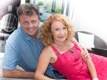 Happy middle aged couple spending romantic time by pool Royalty Free Stock Photo