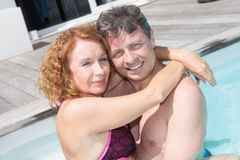 Happy middle-aged couple in a swimming pool Royalty Free Stock Photo