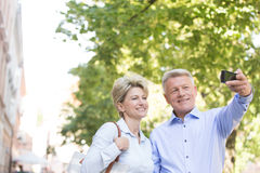 Happy middle-aged couple taking selfie outdoors Royalty Free Stock Photo
