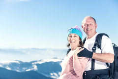 Happy middle aged couple on the top Stock Images