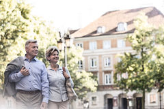 Happy middle-aged couple walking in city Royalty Free Stock Photo
