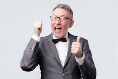 European man in suit showing thumb up royalty free stock photography