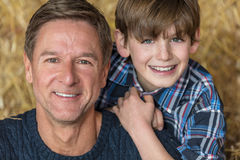 Happy Middle Aged Father and Son Stock Images