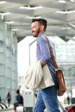 Happy middle aged guy traveling with suitcase Royalty Free Stock Image