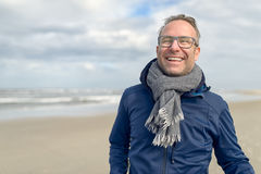 Happy middle-aged man on an autumn beach Stock Photography