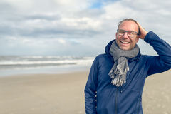 Happy middle-aged man on an autumn beach Royalty Free Stock Image