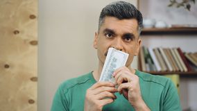 Happy middle-aged man counting dollars, unexpected lottery win, easy money stock footage