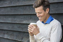 Happy Middle Aged Man Drinking Coffee Stock Images