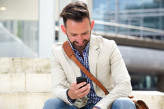Happy middle aged man looking at his cell phone Stock Photo