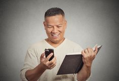 Happy middle aged man reading funny news on smart phone Stock Image