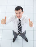 Happy middle aged man  standing on  isolated white background. And shoving thumns up Stock Photos