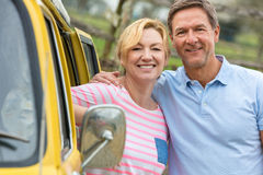Happy Middle Aged Man and Woman Couple With Camper Van Bus Stock Images
