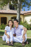 Happy Middle Aged Man Woman Couple Sitting Outside Royalty Free Stock Photography