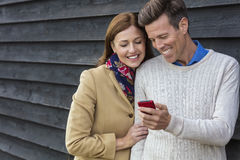 Happy Middle Aged Man Woman Couple Using Cell Mobile Phone Royalty Free Stock Photos