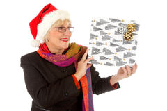 Happy middle aged santa woman, gift Royalty Free Stock Photo