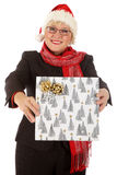 Happy middle aged santa woman, gift Stock Photography