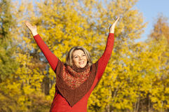 Happy middle aged woman with arms outstretched Royalty Free Stock Photography