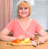 Happy middle-aged woman cooking Royalty Free Stock Photography