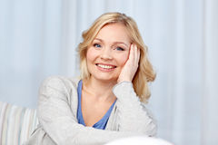Happy middle aged woman at home stock photo