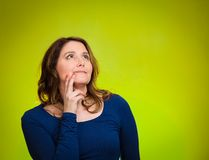 Happy, middle aged woman looking upwards daydreaming Stock Photography