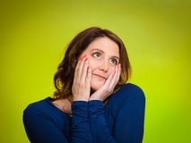 Happy, middle aged woman looking upwards daydreaming Royalty Free Stock Photos