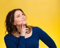 Happy, middle aged woman looking upwards daydreaming. Closeup portrait smiling, joyful, happy, middle aged woman looking upwards daydreaming, thinking isolated Royalty Free Stock Photo