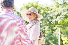 Happy middle-aged woman with man in park Royalty Free Stock Photos