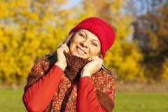 Happy middle aged woman with scarf and cap royalty free stock images