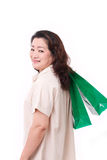 Happy middle aged woman with shopping bag Stock Images